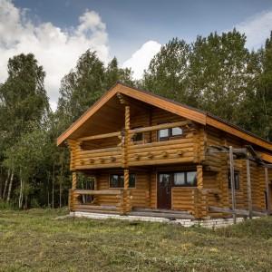 Дом из оцилиндрованного бревна 165 м2 на лесном участке 20 соток